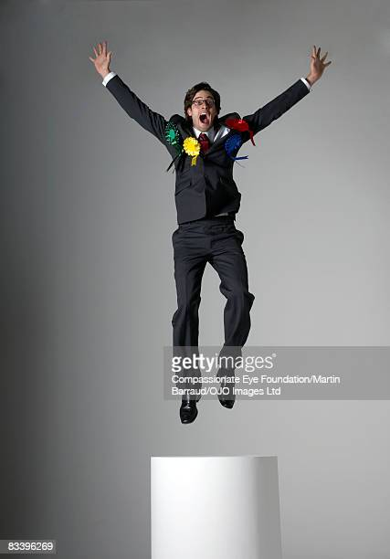 Excited man jumping, wearing many ribbons
