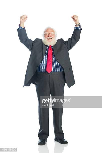 Excited mature businessman celebrating his success