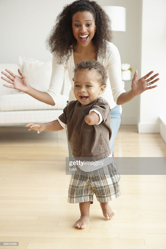 Excited Mother Watching Son Take His First Steps