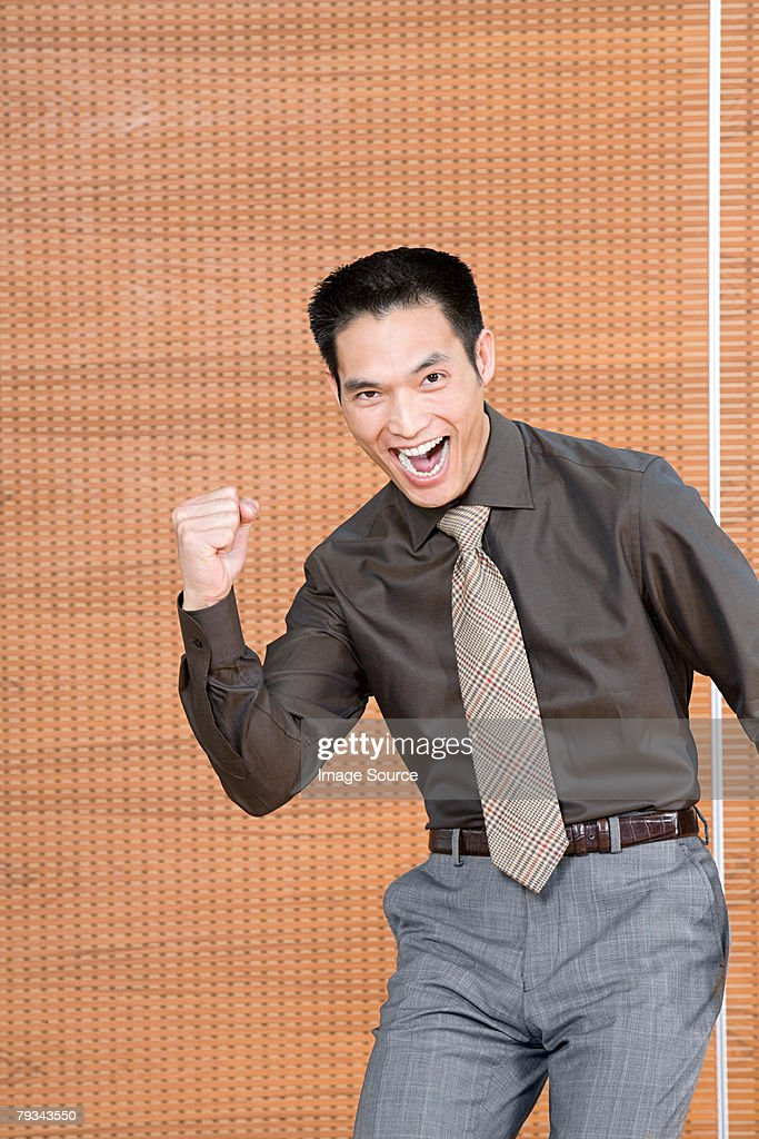 Excited Office Worker Stock Photo | Getty Images