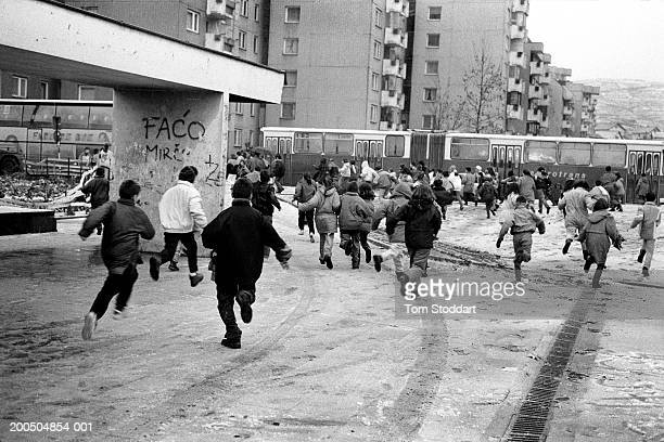 Bosnia Sarajevo December 1996 Excited people and children run to collect Christmas aid packages During the 47 months between the spring of 1992 and...