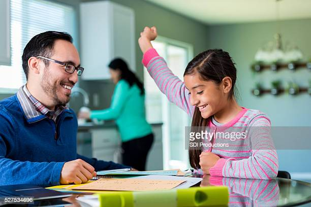 Excited pre-teen girl celebrates after finishing project