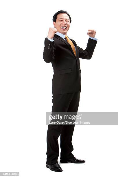 Excited senior businessman punching the air