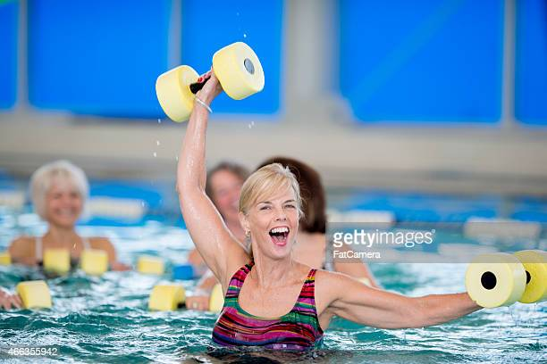 Excited Senior leading Water Aerobics