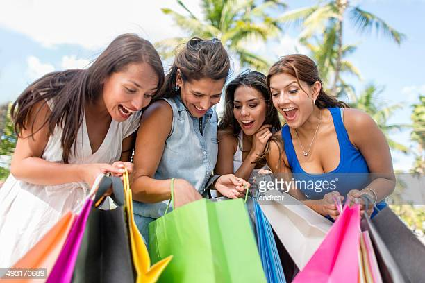 Excited shopping girls