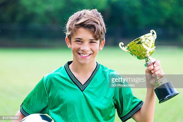 Excited soccer champ with trophy