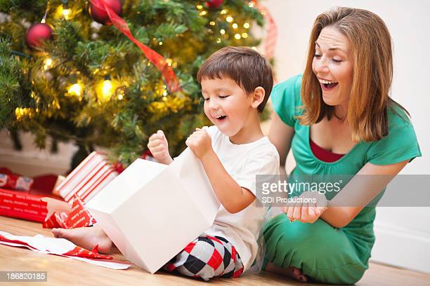 Excited Son Opening Present With Mom on Christmas Morning