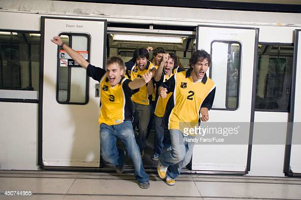 Excited Sports Fans Leaving Subway