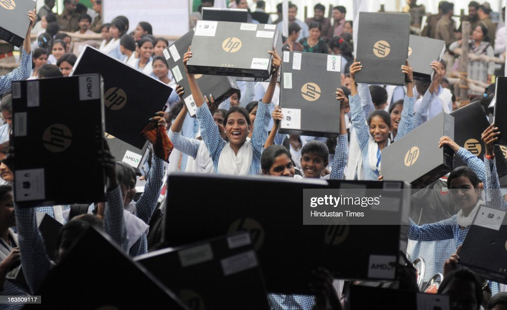 Excited students from a city college after receiving free Laptops on March 11, 2013 in Lucknow, India. Akhilesh Yadav launched the free laptop scheme for intermediate pass students as promised in the manifesto during Assembly elections last year.