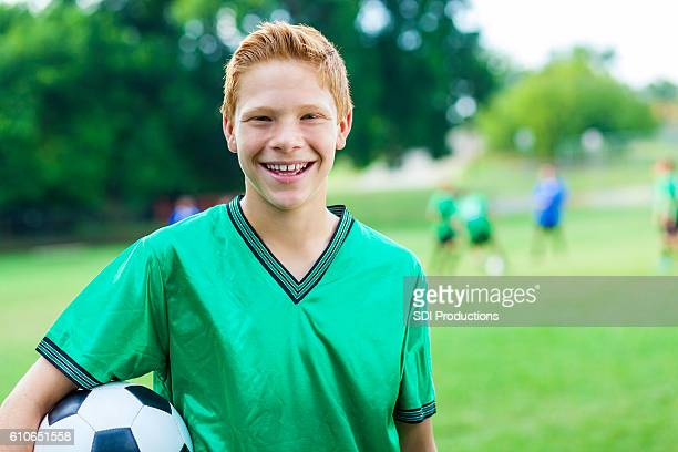 Excited teenage soccer athlete at game