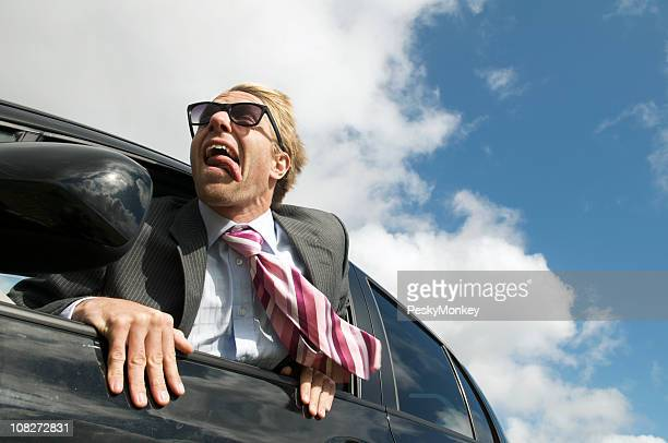 Excited Traveling Businessman Hanging Out Car Window