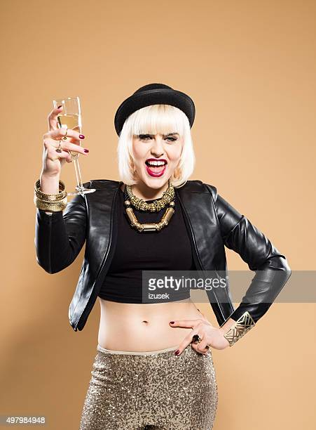 Excited woman celebrating New Year's Day with glass of champagne