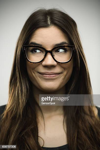 Excited woman smiling against gray background