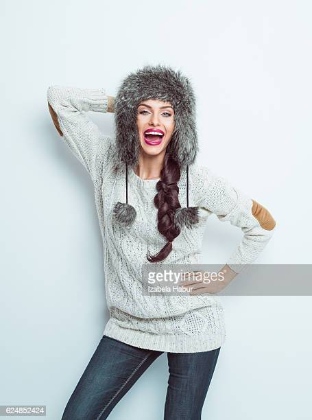 Excited woman wearing fur hat