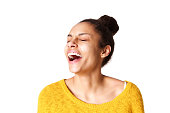 Close up portrait of excited young african woman laughing against white background