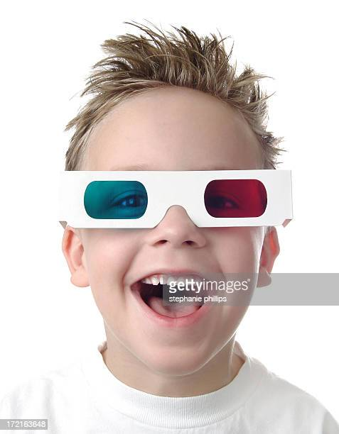 Excited Young Boy with 3D Glasses on White Background