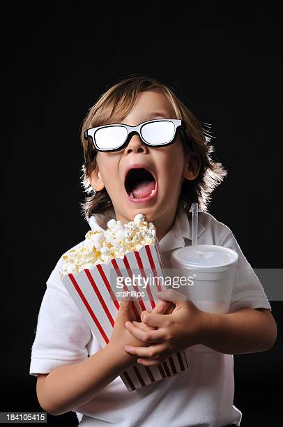 Excited Young Boy with 3D Glasses Theater Popcorn and Drink