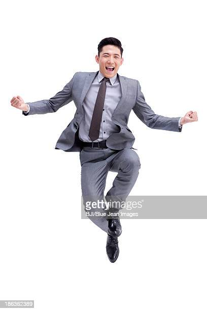 Excited young businessman cheering