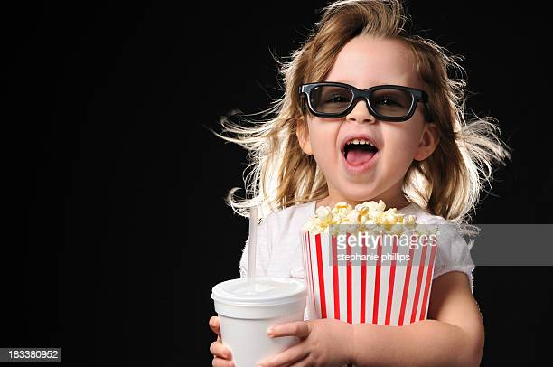 Excited Young Girl with 3D Glasses Theater Popcorn and Drink