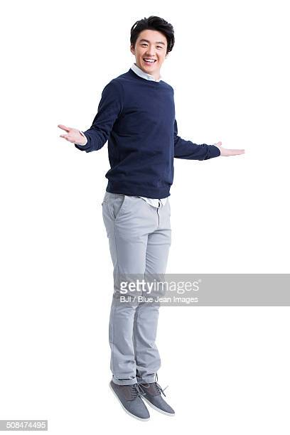 Excited young man jumping
