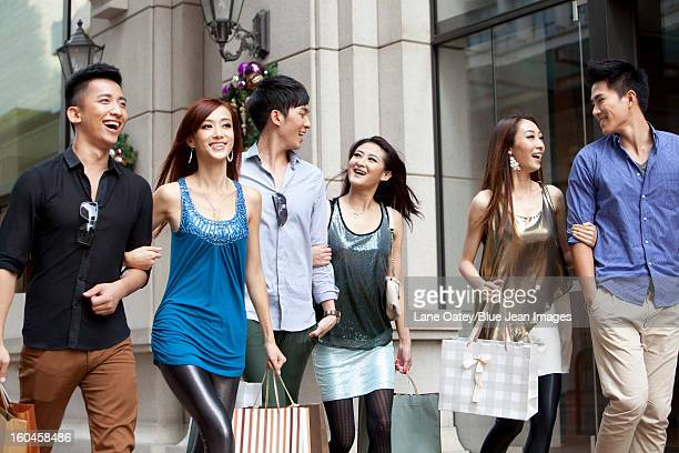 Excited young people go shopping on the street of Hong Kong