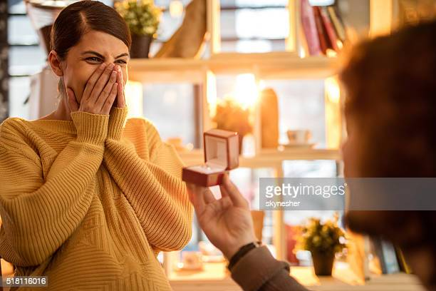 Excited young woman getting engaged.