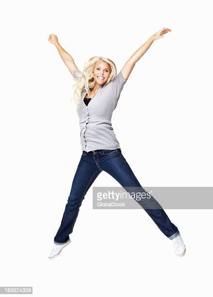 Excited young woman jumping