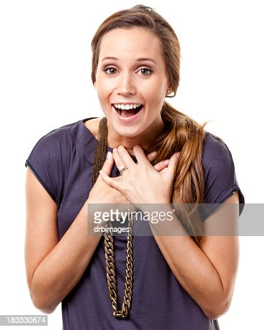 Excited Young Woman With Hands On Chest