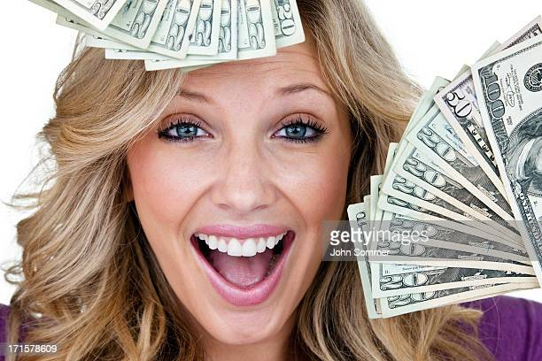 Excited young woman with lots of cash
