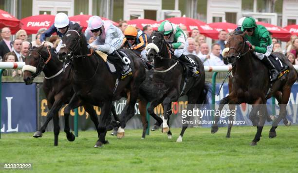 Exclamation ridden by jockey Jamie Spencer [pink] wins the 250000 Tattersalls October Auction Stakes at Newmarket Racecourse Newmarket Cambridgeshire
