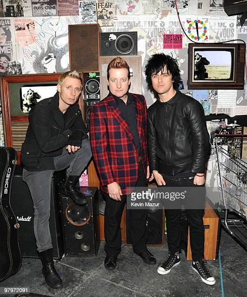 NEW YORK MARCH 23 *Exclusive* Mike Dirnt Tre Cool and Billie Joe Armstrong of Green Day backstage during the 'American Idiot' final soundcheck at St...