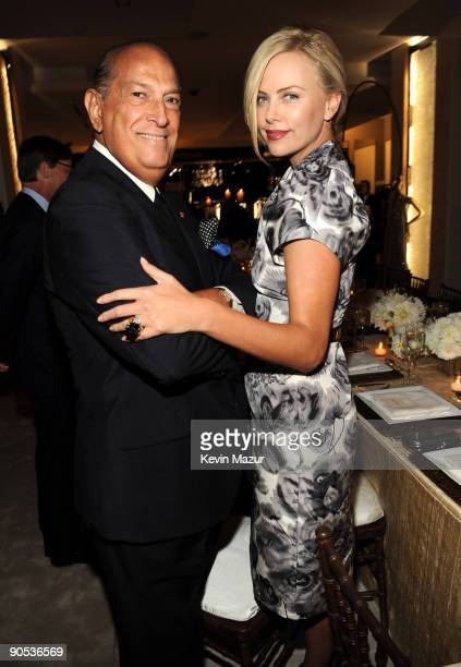 NEW YORK SEPTEMBER 09 *Exclusive* Oscar de la Renta and Charlize Theron attend the launch of the new designers floor at Saks Fifth Avenue on...