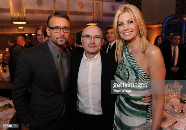 NEW YORK MARCH 15 *Exclusive* Tim McGraw and Faith Hill pose with inductee Phill Collins at the 25th Annual Rock and Roll Hall of Fame Induction...