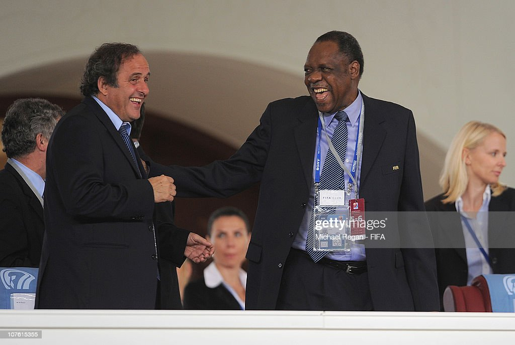 Ex-Co members Issa Hayatou and Michel Platini share a joke during the FIFA Club World Cup match between Seongnam Ilhwa Chunma FC and Inter Milan at Zayed Sports City on December 15, 2010 in Abu Dhabi, United Arab Emirates.