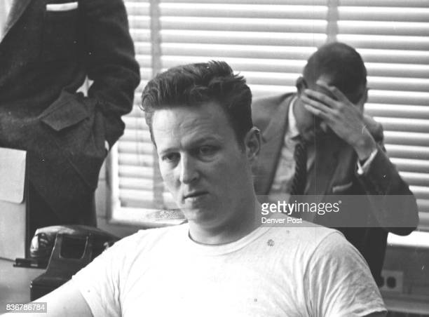 Exconvict David Francis Early sits in the Sheriff's office for questioning In back head in hand is one of Knight's law partners Richard Schmidt...