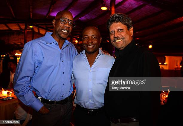 ExCricketers Kapil Dev and Brian Lara pose with Dr Edwin Moses at the Welcome Dinner presented by Autism Rocks prior to The Costa Smeralda...