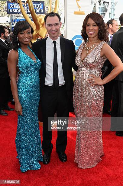ABC execs Channing Dungey Paul Lee and Nne Ebong arrive at the 65th Annual Primetime Emmy Awards held at Nokia Theatre LA Live on September 22 2013...