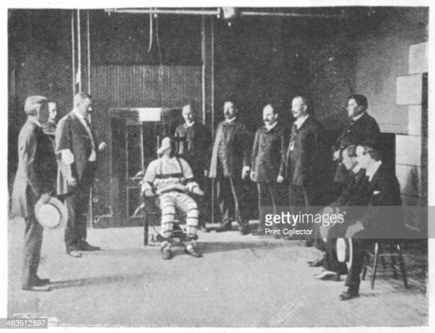 Execution by electric chair United States 1898 The warden holds a handkerchief in his left hand The doctor holds his watch The electrician stands...