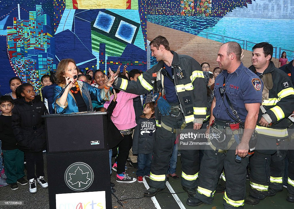 Executive and Creative Director of CITYarts, Inc., Tsipi Ben-Haim (L) and members of NYC FDNY attend the CityArts & Disney 'Celebrating The Heros Of Our City' Mural Ribbon Cutting at Henry M. Jackson Playground on November 6, 2013 in New York City.