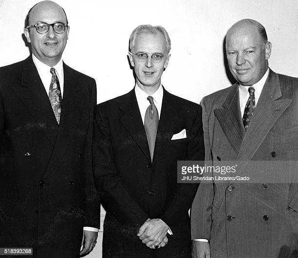 Executive Ben Cohen American television host Lynn Poole and Dr Allen B DuMont are standing in order from left to right they are all wearing business...