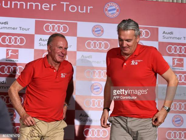 Executive board chairman of FC Bayern KarlHeinz Rummenigge and executive board member Jorg Wacker attend a press conference in Singapore on July 27...
