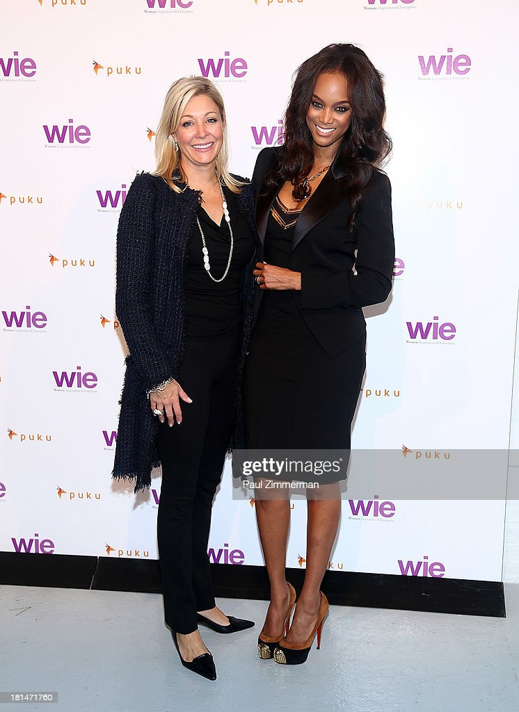 Executive Board member, Nadja Swarovski (L) and Tyra Banks attend the 4th Annual WIE Symposium at Center 548 on September 21, 2013 in New York City.