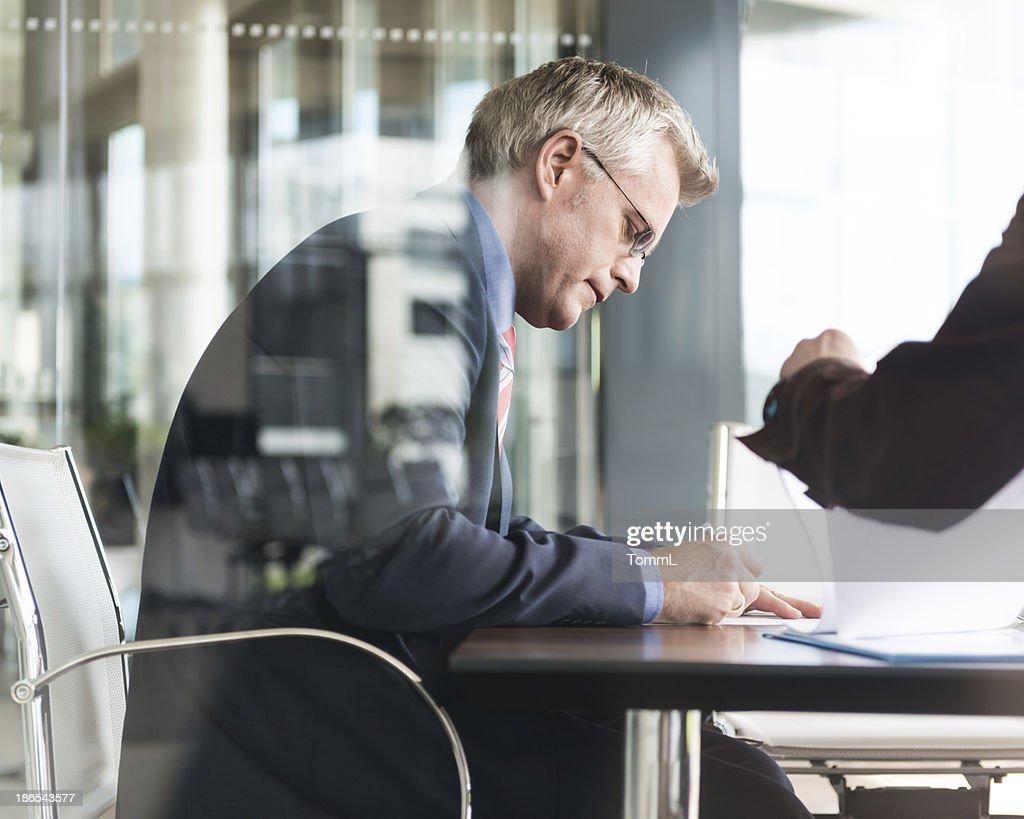 Executive Businessman Signing Paperwork
