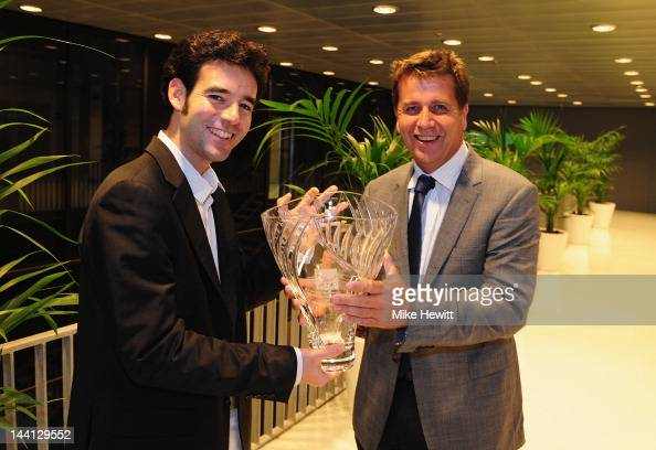 Executive Chairman Brad Drewett presents Juan Jose Mateo of El Pais with the 2011 Ron Bookman ATP Media Award during the Mutua Madrilena Madrid Open...