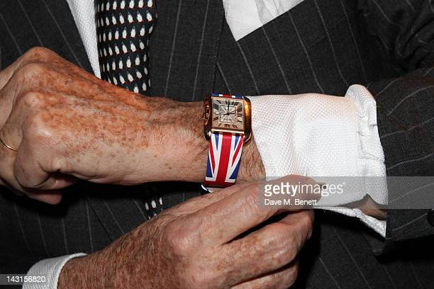 Executive Chairman of Cartier UK Arnaud Bamberger displays a watch as he attends the launch party for the Cartier Tank Anglaise Watch Collection at...