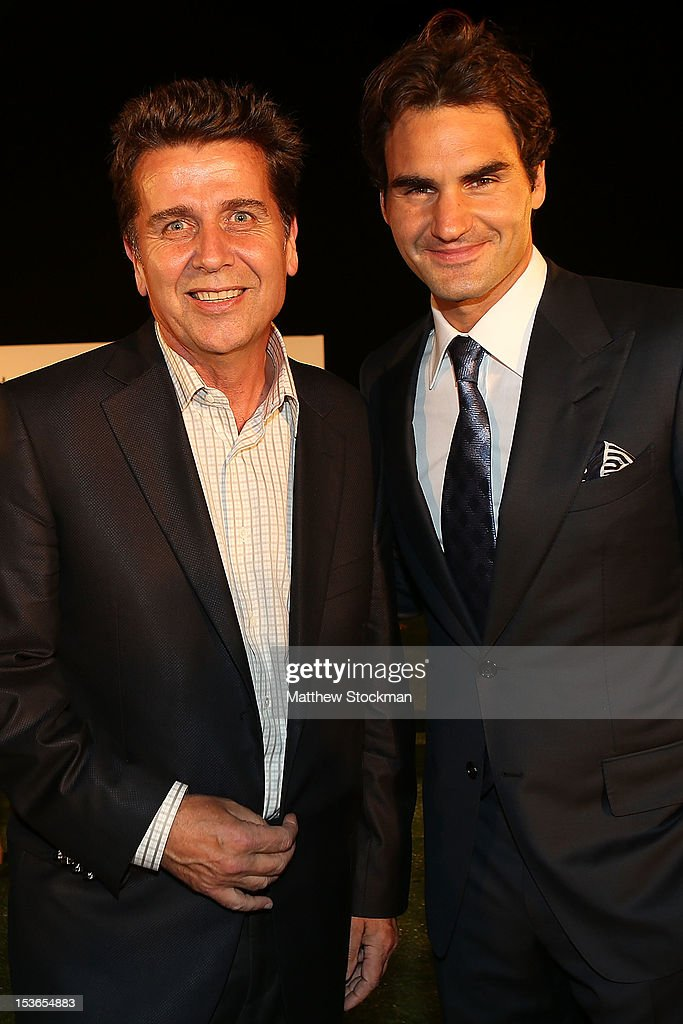 Executive Chairman President Brad Drewett poses for photographers with Roger Federer of Switzerland during a reception for the Shanghai Rolex Masters...