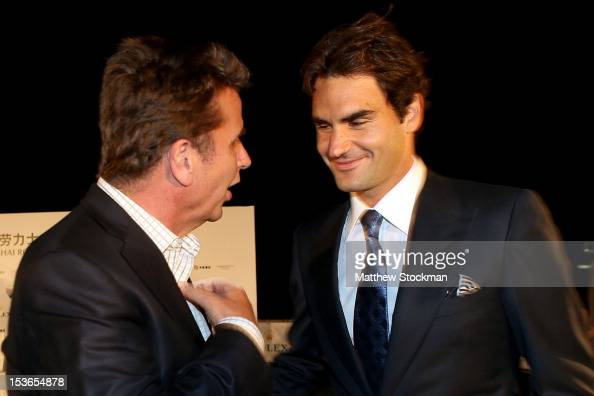 Executive Chairman President Brad Drewett talks to Roger Federer of Switzerland during a reception for the Shanghai Rolex Masters at the Hilton Hotel...