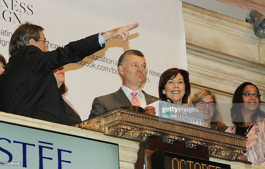 Executive chairman William P. Lauder (C) and Maureen Case, president of luxury cosmetic brands La Mer, Jo Malone and Bobbi Brown (center right) visit the New York Stock Exchange in celebration of the 20th Anniversary of the Estee Lauder Companies' Breast Cancer Awareness Campaign on October 1, 2012 in New York City.