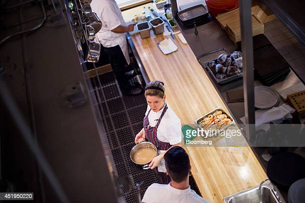 Executive chef Casey Thompson center talks to a member of staff at Aveline restaurant in San Francisco California US on Wednesday July 9 2014 A labor...