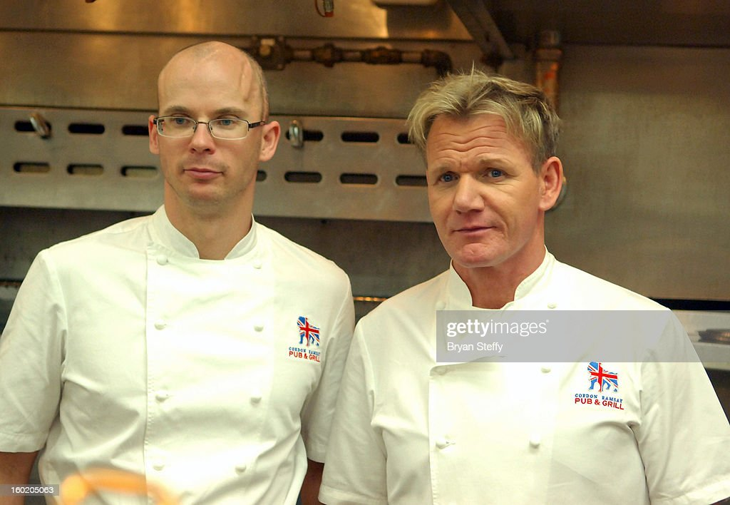 Executive chef Jeremy Berlin (L) and television personality and chef Gordon Ramsay appear during a traditional Sunday Roast at Gordon Ramsay Pub & Grill at Caesars Palace in celebration of the opening of the restaurant as well as Gordon Ramsay BurGR at Planet Hollywood Resort & Casino on January 27, 2013 in Las Vegas, Nevada.